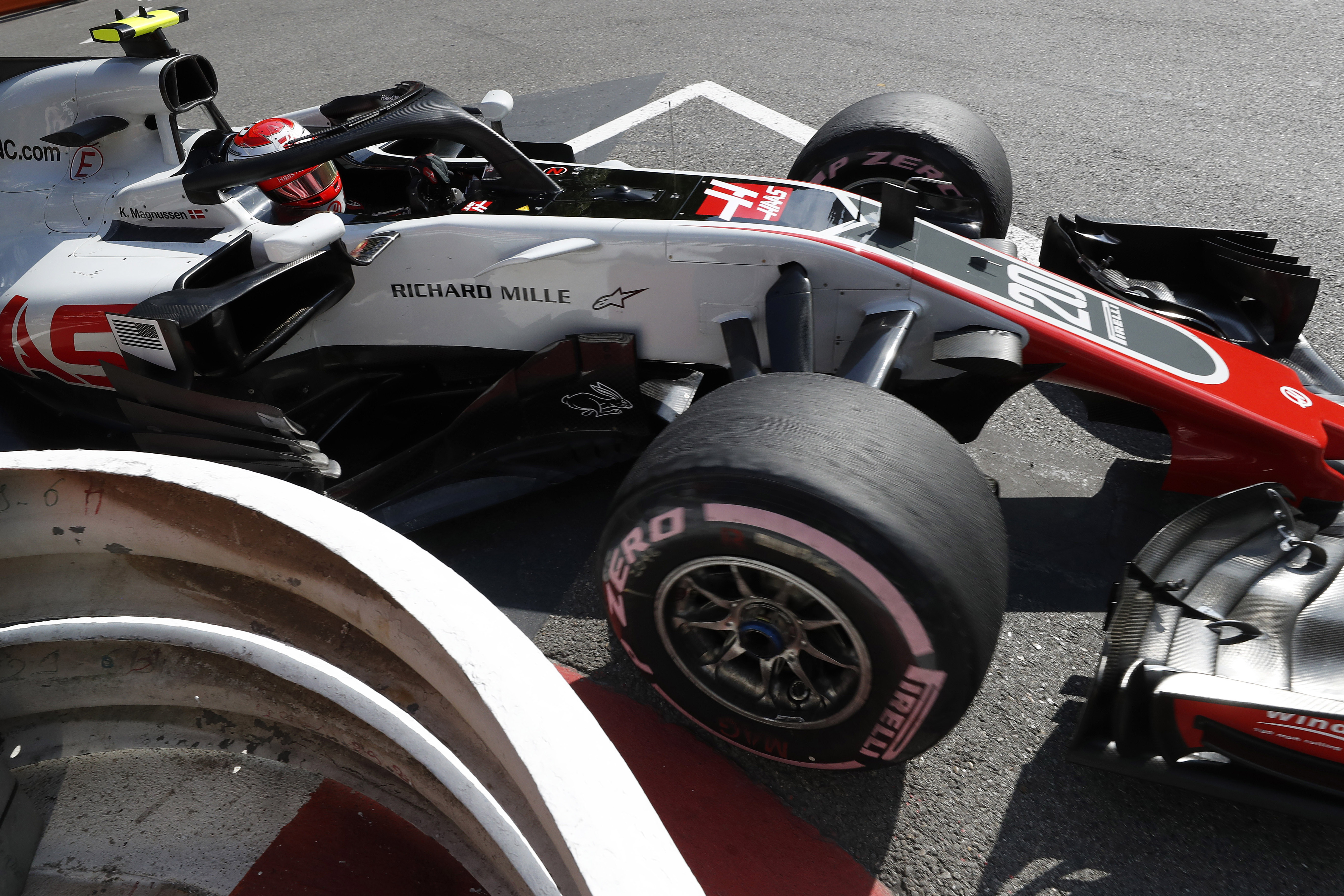 Magnussen's car in the pit