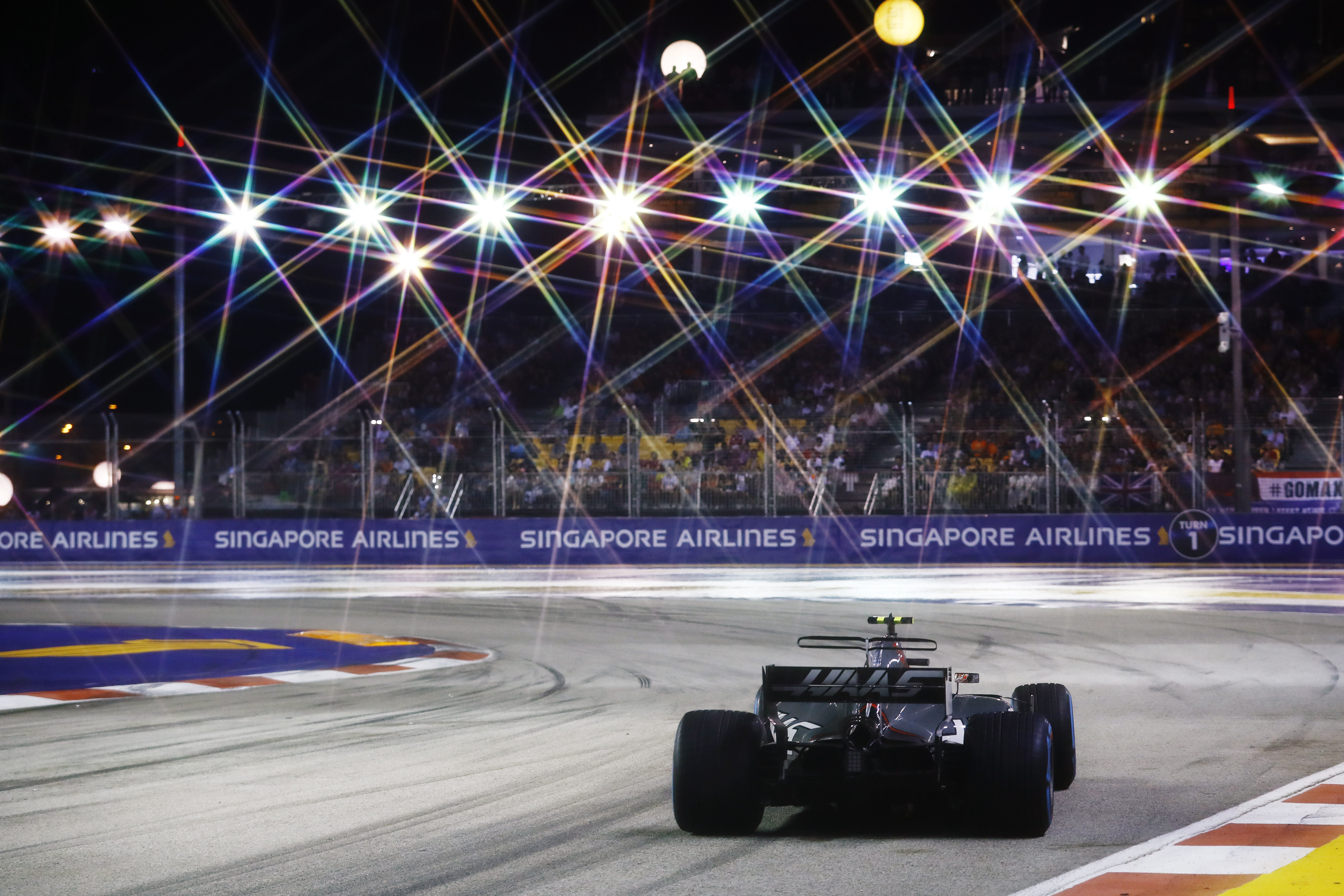 Racecar on Formula 1 track at night