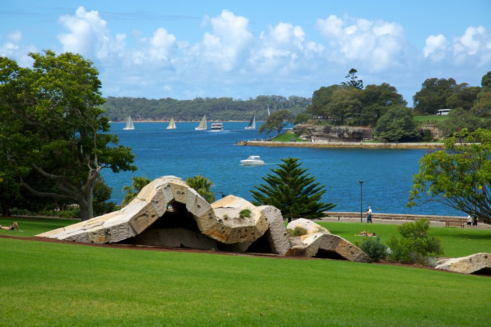 View of abstract sculpture on a grassy hill at the Royal Botanic Gardens