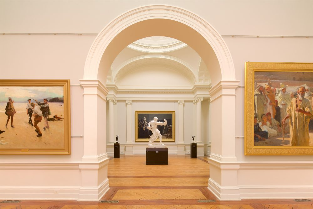 View of a statue through an arched doorway in the Art Gallery of NSW