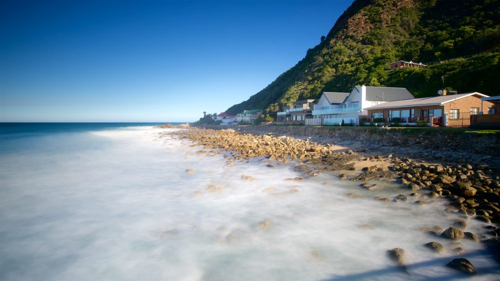 Beach, cliffs and home on the coast of Victoria Bay Beach in South Africa